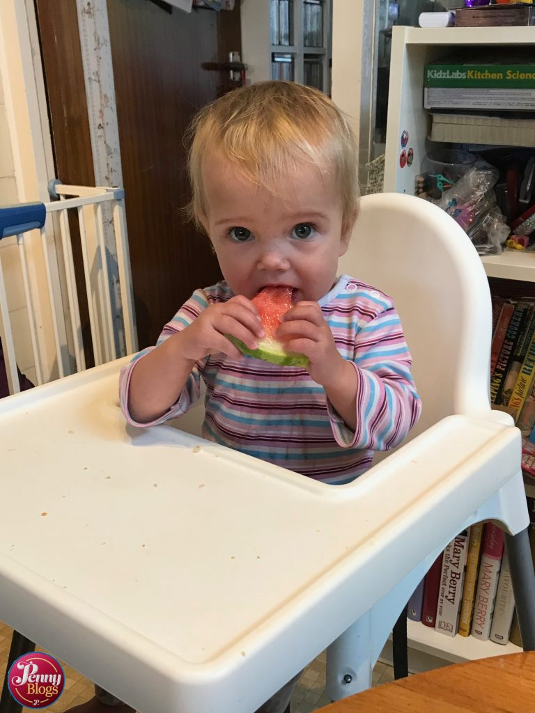 September - Tube Stop Baby eating watermelon in her high chair